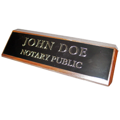This elegant, genuine Texas notary walnut desk, sign is made of solid wood and engraved on a metal plate with gold lettering with your notary name and the wording 'Notary Public'. It makes a fine addition to any desk or office. This sign can be customized with up to two lines.